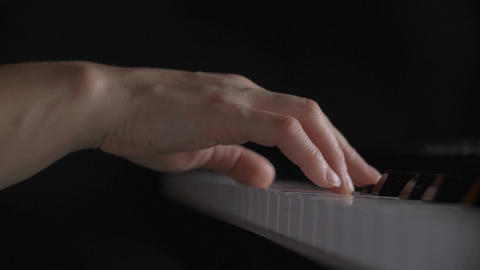 woman's hand playing the piano Footage