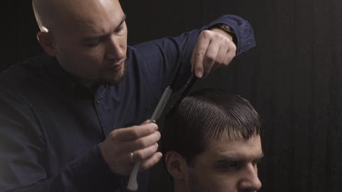 Professional haircut with razor at the beauty salon Live Action