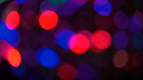 Moving particles. Colorful, blurred, bokeh lights background Footage