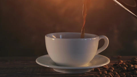 steaming coffee on dark brown background Footage