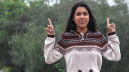 Latina Hispanic Girl Talking Wearing Sweater Cold Weather Live Action