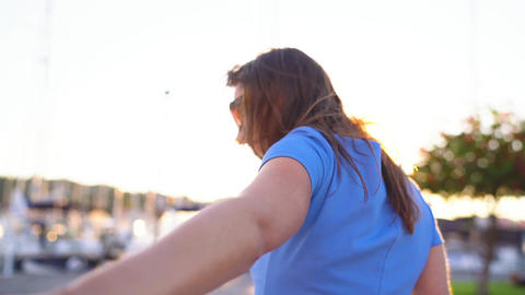 Follow me - happy young woman in sunglasses pulling guy's... Stock Video Footage