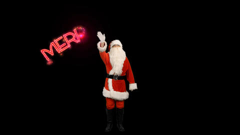 Santa Claus makes sparkler text animation Merry Christmas, alpha channel Footage