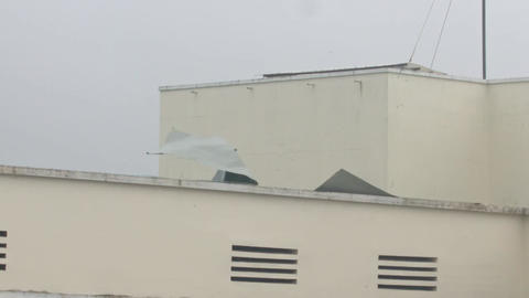 Strong Wind Shakes House Roof Ruberoid Coating under Hurricane Footage