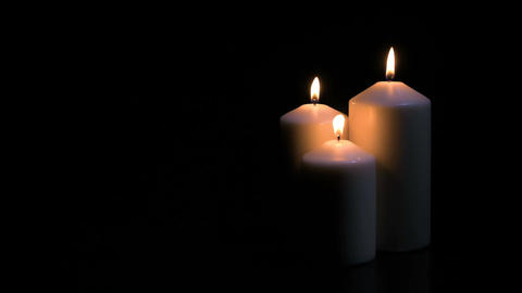 Candles burning on black background Footage