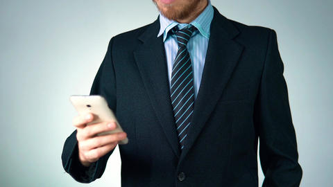 stylish, elegant man in a suit is holding a phone in his hands. businessman Footage