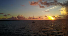 v08496 yacht boat sailing at sunrise and sunset with view from aerial flying Footage
