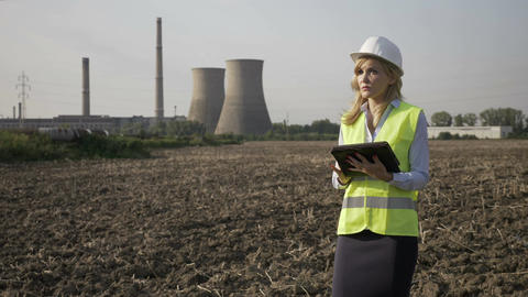 Portrait of beautiful specialist engineer woman working on tablet on industrial Footage