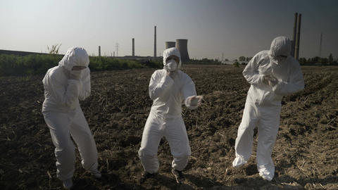 Engineers workers dressing protective hazmat clothes intoxicated with nuclear Live Action