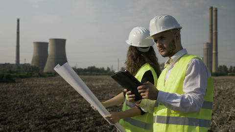 Man and female engineers coworkers analyzing and checking scheme project plans Footage