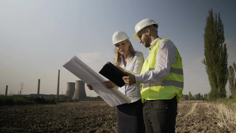 Survey young architect engineers team on energetic power plant completing Footage