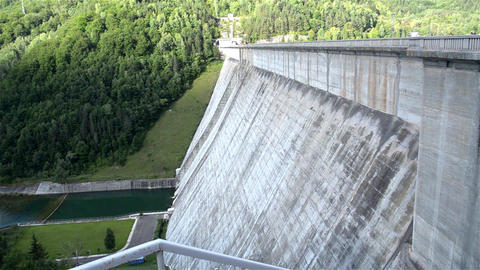 Concrete dam built between two mountain slopes and that close a artificial lake  Footage