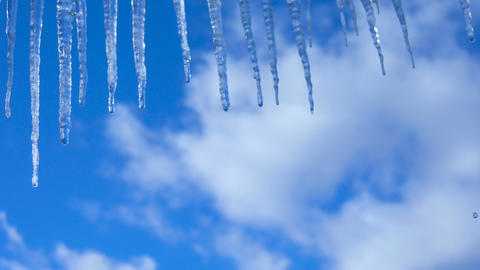 Icicles on a background of blue sky Animation