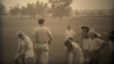 1937: Kids burlap potato sack race in western cowboy hats for fun Footage