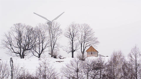 Wind farms built on a hill and covered by drifts of snow 5b Footage