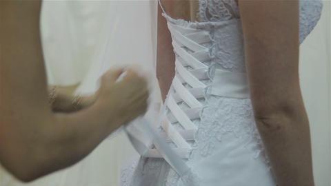 Dressing bride in wedding salon Live Action