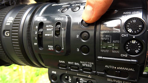 Cameraman press different buttons on the your camcorder to change the working pa Footage