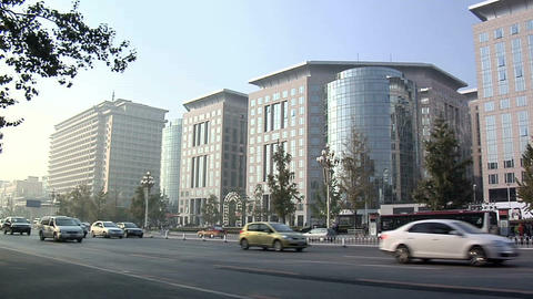 Traffic on Chang'an Jie with the Oriental Plaza and the Beijing Hotel at the lef Footage