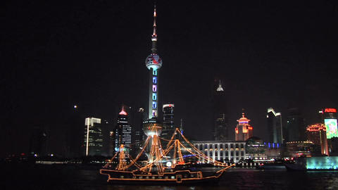 Skyline of Pudong with Oriental Pearl TV Tower and Sight Seeing Boat on the Huan Live Action