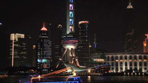 Oriental Pearl TV Tower and the lit Skyline of Pudong at Night Live Action