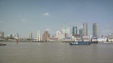 River Boats On The Huangpu River And As Background The Skyline Of The Northern P stock footage