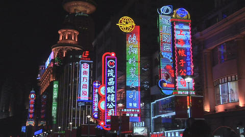 Colorful Neon Signs on Nanjing Road East Pan to the Right Live Action