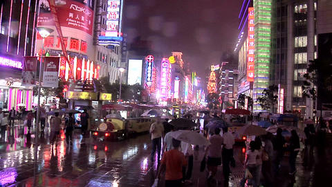 Pedestrians on a Rainy Evening in Nanjing Road East Live Action