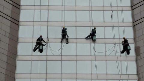 Window Cleaner cleaning a Glass Façade of a Department Store Live Action