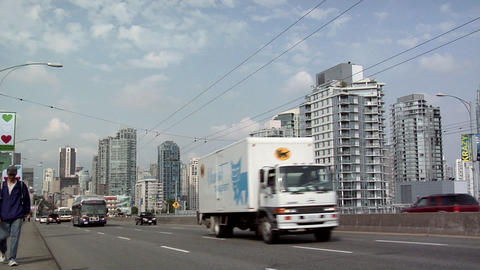 Electric Public Bus and other Traffic on Granville Bridge, Vancouver Footage