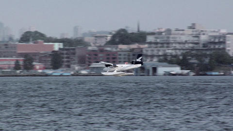 Water Plane taking off from Coal Harbour/ Canada Place, Vancouver Footage