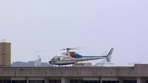 Private Helicopter Landing On The Rooftop Of A Building In Manila, Philippines stock footage
