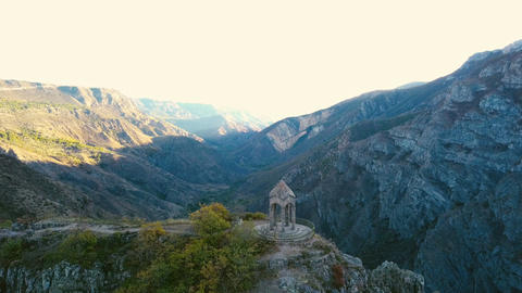A small chapel on the mountain edge against at the morning. Aerial shot Footage