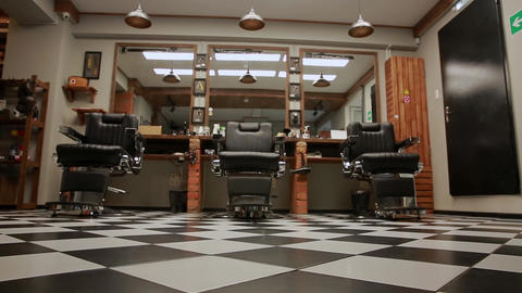 the camera on the Steadicam shows the interior of a Barber shop with a beautiful Archivo