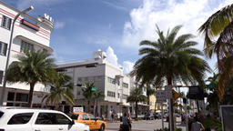 USA Florida Miami Beach intersection with car traffic in Collins Avenue Footage