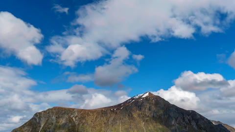 Time lapse footage of clouds passing dramatic mountain landscape Footage