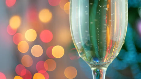 Champagne pour with Christmas lights into glass Footage
