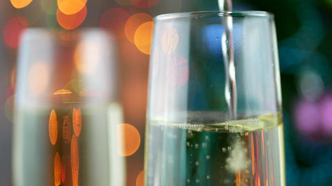 Sparkling wine over holiday bokeh blinking background Footage