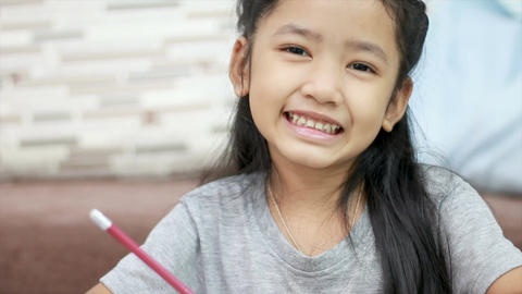 Asian little girl smiling with happiness with copy space composition 002 Footage