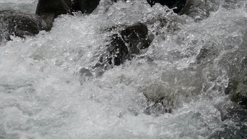 fast flow of mountain stream closeup, slow motion Footage