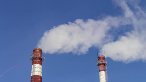 pipe with smoke against the sky. air pollution by industrial enterprises. the Footage