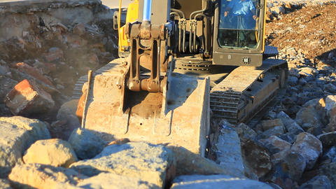 Excavator operating in a rock quarry. Hydraulic excavator works for formation of Footage