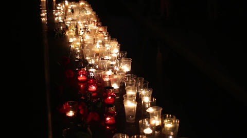 Flowers and candles on the memorial of those killed by the terrorist attack. Act Footage