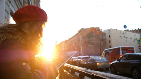 Young attractive girl with tablet in the sunset in the... Stock Video Footage