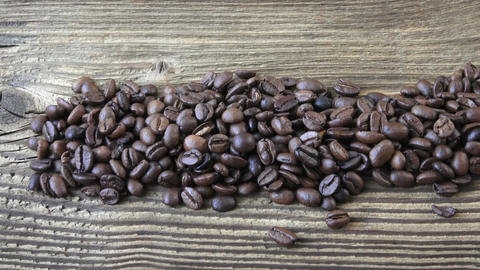 Raw coffee beans. Coffee beans on wood background Footage
