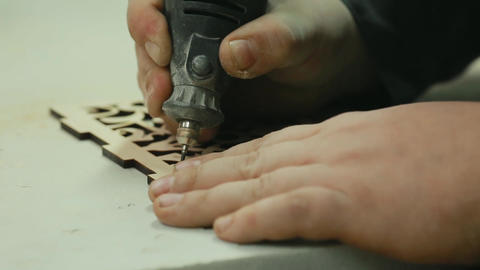 The enterprise of male hands produce grinding and rounding corners wood products Footage