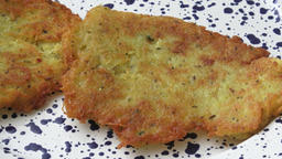 Fried pancakes from the potatoes on the plate Live Action