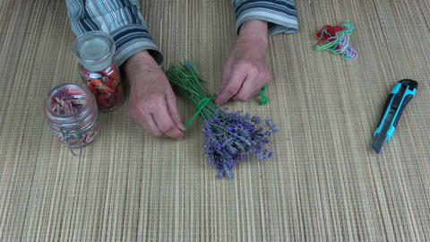 Old woman hands binding lavender bunch Live Action