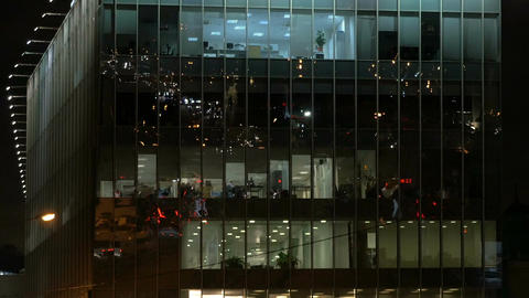 International business center, works 24 hours. High-rise building, office lights Footage