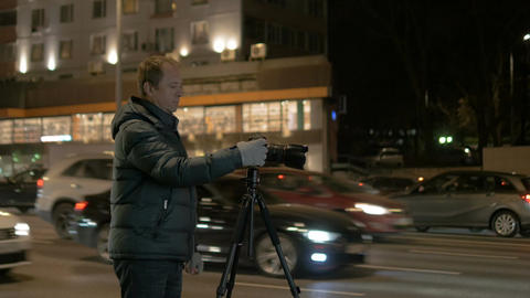Man taking pictures of the night landscape Footage