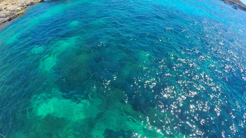 Turquoise clear water behind board the yacht Live Action